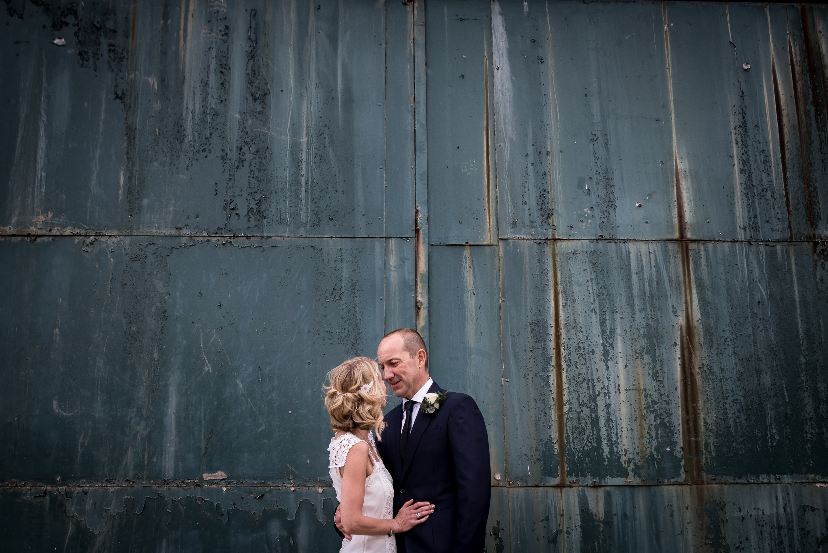 Wedding couple in front of blue rusty door