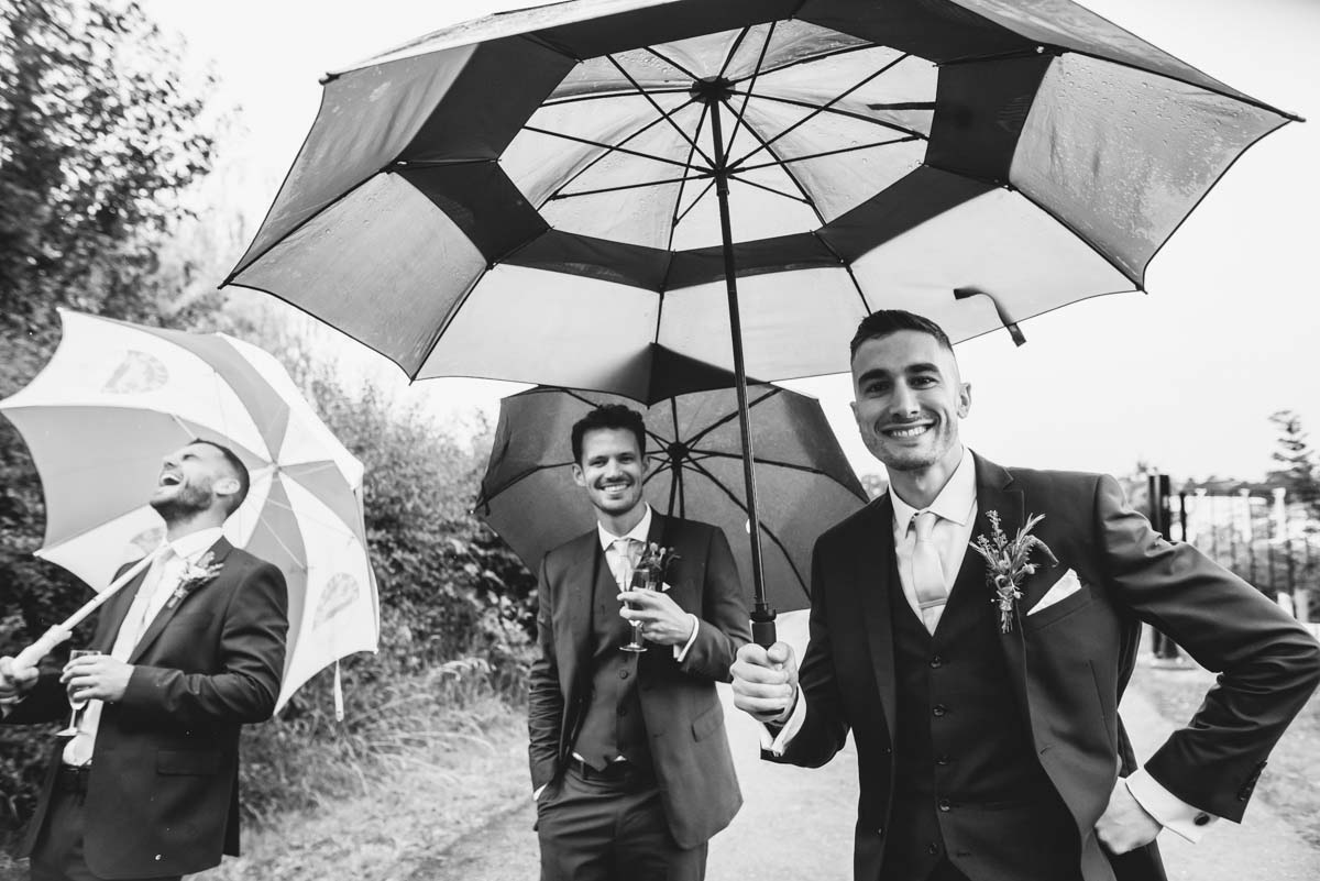 grooms men in the rain