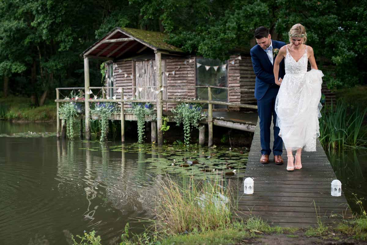 bride and groom on the bridge