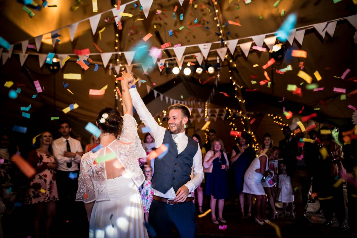 couple in a tipi with confetti canon
